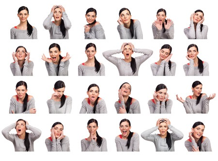 22261855 - young woman showing several expressions, isolated on white background.